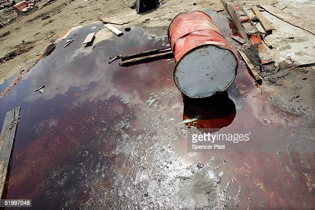Barrel Lies In Pool Of Oil On The Premises Damaged Petroleum Picture Indonesia Struggles With Black