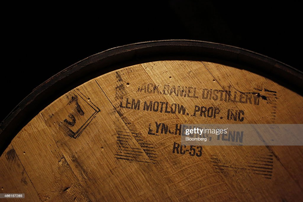A barrel of Jack Daniel's Tennessee Whiskey ages in a warehouse at Jack Daniel's Distillery in Lynchburg, Tennessee, U.S., on Thursday, Jan. 30, 2014. Jack Daniel's is owned by Brown-Forman Corp., which announced a regular quarterly cash dividend of 29 cents per share on its Class A and Class B Common stock last week in a company press release. Photographer: Luke Sharrett/Bloomberg via Getty Images