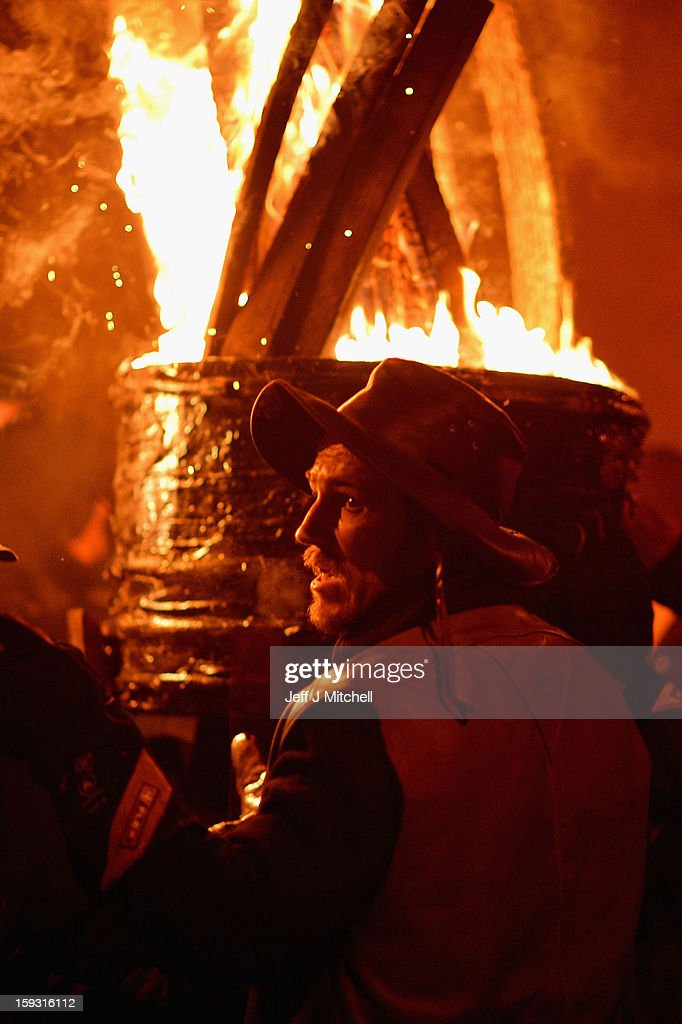 A barrel packed with tar soaked sticks burns during The Burning Of The Clavie Festival on January 11, 013 in Burghead, Scotland. The festival takes place on January 11 each year as local people welcome in the New Year with a fire ceremony, which has ancient roots believed to bring good luck for the coming year.