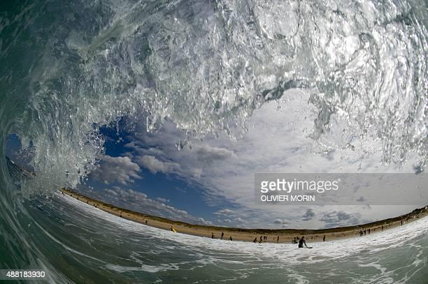 A barrel tube wave breaks on September 11 2015 off Cap Ferret southwestern France AFP PHOTO / OLIVIER MORIN
