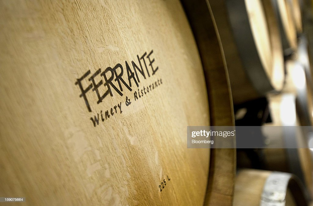 Barrels filled with wine sit in the cellar at the Ferrante Winery in Geneva, Ohio, U.S., on Friday, Jan. 4, 2013. Ice wine is a type of dessert wine produced from grapes that have been frozen while still on the vine, because the sugars and other dissolved solids do not freeze, but the water does, this allows a more concentrated grape must to be pressed. Photographer: Ty Wright/Bloomberg via Getty Images