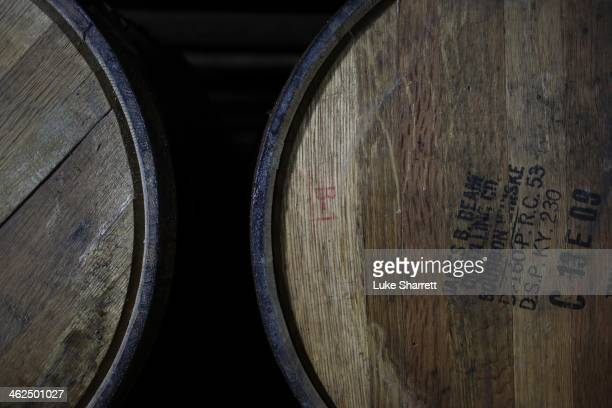 Barrels of Bourbon age inside a warehouse at the Jim Beam Bourbon Distillery on January 13 2014 in Clermont Kentucky Japanese company Suntory...