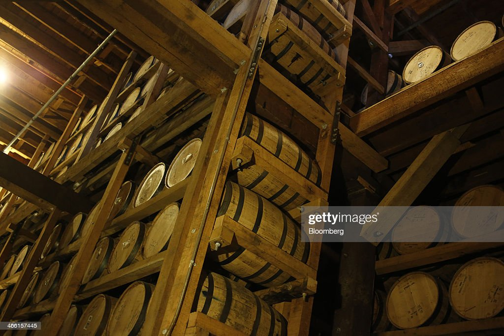 Barrels of Jack Daniel's Tennessee Whiskey age in a warehouse at Jack Daniel's Distillery in Lynchburg, Tennessee, U.S., on Thursday, Jan. 30, 2014. Jack Daniel's is owned by Brown-Forman Corp., which announced a regular quarterly cash dividend of 29 cents per share on its Class A and Class B Common stock last week in a company press release. Photographer: Luke Sharrett/Bloomberg via Getty Images