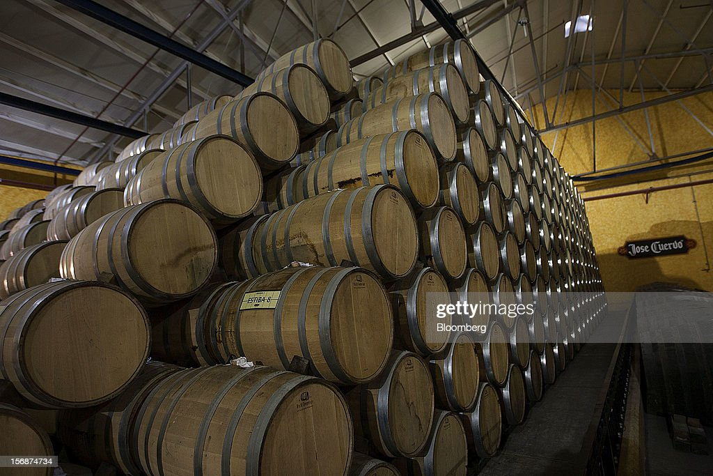 Barrels of Jose Cuervo tequila sit stacked in the cellar of the Tequila Cuervo La Rojena S.A. de C.V. distillery plant in Guadalajara, Mexico, on Thursday, Nov. 22 2012. There are more than 200 types of agave in Mexico, but use of the blue agave plant was made compulsory in the last century to the issuance of the Official Mexican Standard for Tequila production. Photographer: Susana Gonzalez/Bloomberg via Getty Images