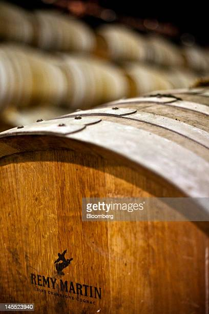 Barrels of Remy Martin Fine Champagne Cognac are laid to age in a cellar at the Remy Cointreau SA headquarters in Cognac France on Thursday May 31...