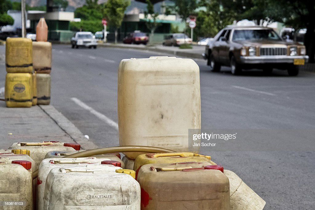 Barrels of the smuggled Venezuelan gasoline are sold along the highways in the border region, close to Cucuta, Colombia, on 2 May 2006 in La Parada, Colombia. Venezuelan gasoline, being 20 times cheaper than in Colombia, is the most wanted smuggling item, followed by food and car parts, while reputable Colombian clothing flow to Venezuela. There are about 25,000 barrels of gasoline crossing illegally the Venezuelan border every day. The risky contraband smuggling, especially during the rainy season when the river rises, makes a living to hundreds of poor families in communities on both sides of the frontier.