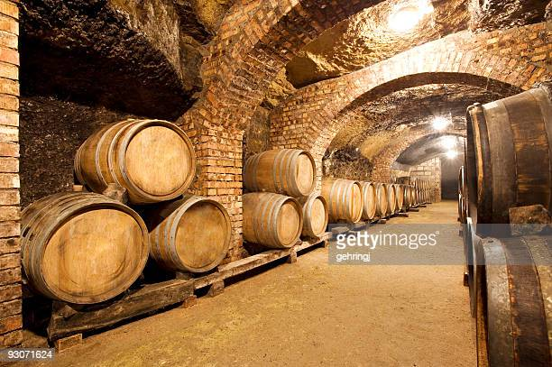 Barrels sitting in a wine cellar