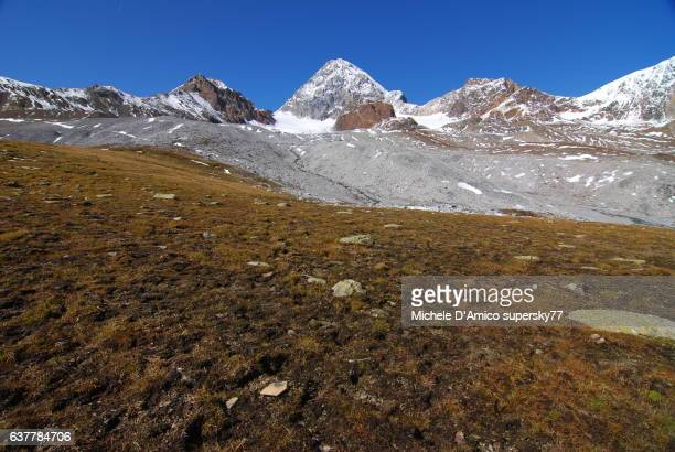 Barren alpine tundra and snow-covered peaks in the Italian Alps