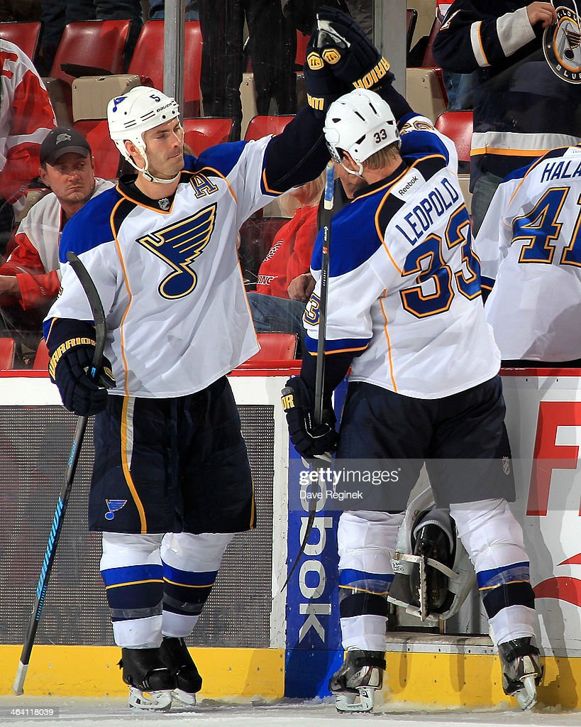 <a gi-track='captionPersonalityLinkClicked' href=/galleries/search?phrase=Barret+Jackman&family=editorial&specificpeople=213384 ng-click='$event.stopPropagation()'>Barret Jackman</a> #5 of the St. Louis Blues gives teammate <a gi-track='captionPersonalityLinkClicked' href=/galleries/search?phrase=Jordan+Leopold&family=editorial&specificpeople=201885 ng-click='$event.stopPropagation()'>Jordan Leopold</a> #33 a high-five before leaving the ice after an NHL game against the Detroit Red Wings on January 20, 2014 at Joe Louis Arena in Detroit, Michigan. The Blues defeated the Wings 4-1