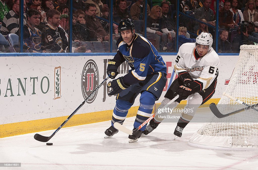 <a gi-track='captionPersonalityLinkClicked' href=/galleries/search?phrase=Barret+Jackman&family=editorial&specificpeople=213384 ng-click='$event.stopPropagation()'>Barret Jackman</a> #5 of the St. Louis Blues handles the puck as <a gi-track='captionPersonalityLinkClicked' href=/galleries/search?phrase=Emerson+Etem&family=editorial&specificpeople=6365314 ng-click='$event.stopPropagation()'>Emerson Etem</a> #65 of the Anaheim Ducks defends in an NHL game on March 16, 2013 at Scottrade Center in St. Louis, Missouri.