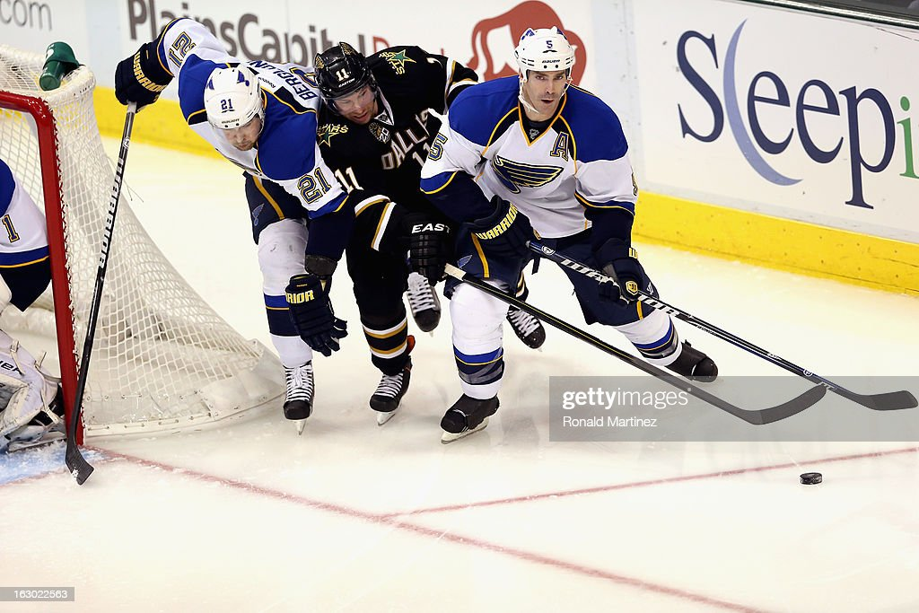 <a gi-track='captionPersonalityLinkClicked' href=/galleries/search?phrase=Barret+Jackman&family=editorial&specificpeople=213384 ng-click='$event.stopPropagation()'>Barret Jackman</a> #5 of the St. Louis Blues skates the puck past <a gi-track='captionPersonalityLinkClicked' href=/galleries/search?phrase=Derek+Roy&family=editorial&specificpeople=203272 ng-click='$event.stopPropagation()'>Derek Roy</a> #11 of the Dallas Stars at American Airlines Center on March 3, 2013 in Dallas, Texas.