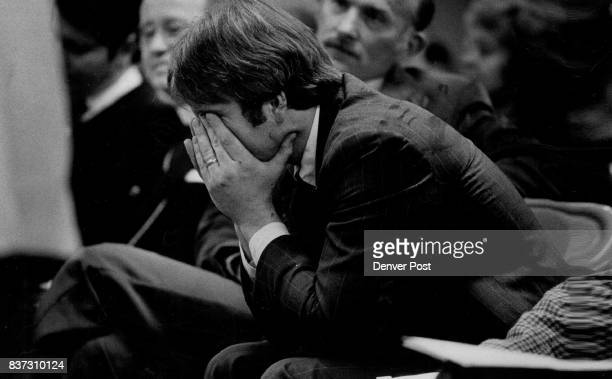 Barrett Nevard holds his head in his hands while pleading with the Board of Trusties not to sell out Rockmont College He is a member of the Facalty...