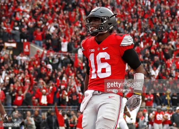 T Barrett of the Ohio State Buckeyes celebrates after rushing for a touchdown in overtime against the Michigan Wolverines at Ohio Stadium on November...
