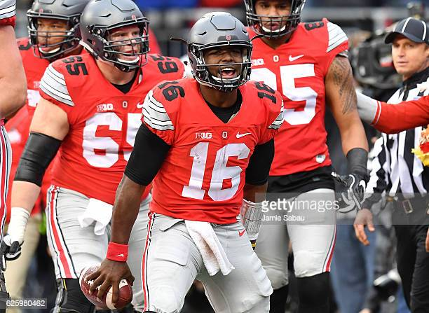 T Barrett of the Ohio State Buckeyes celebrates after scoring a touchdown in overtime against the Michigan Wolverines at Ohio Stadium on November 26...