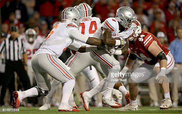 T Barrett of the Ohio State Buckeyes hands the ball off to Curtis Samuel in the first quarter at Camp Randall Stadium on October 15 2016 in Madison...