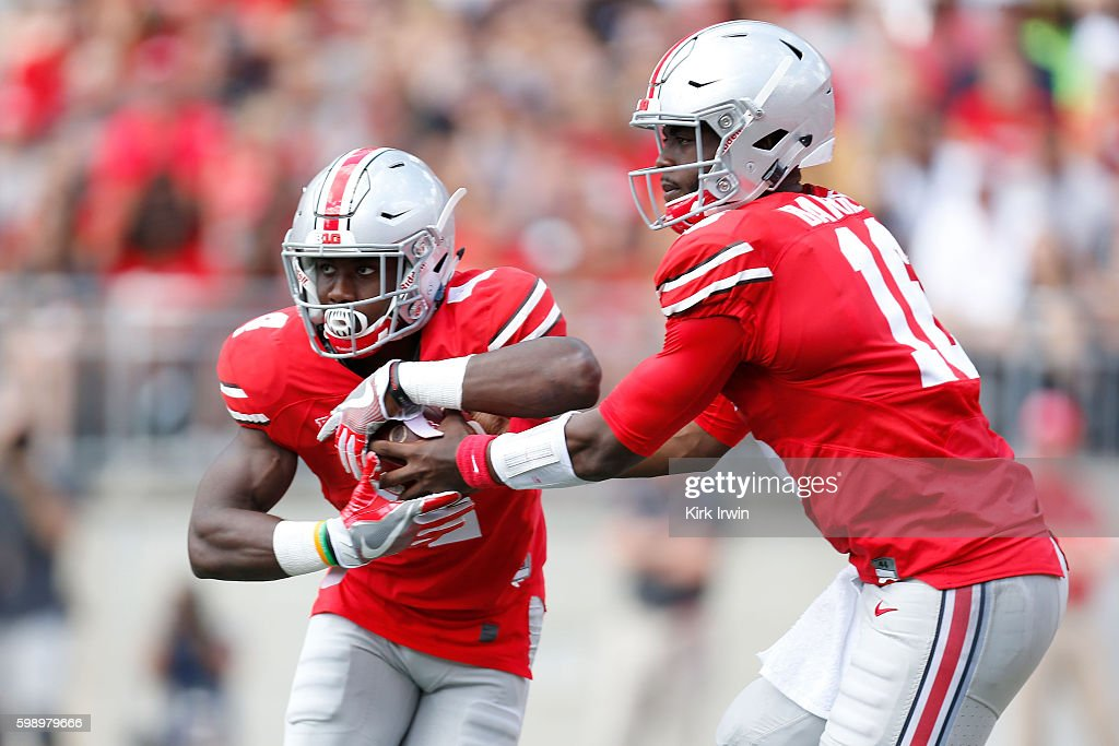 J.T. Barrett #16 of the Ohio State Buckeyes hands the ball off to Curtis Samuel #4 of the Ohio State Buckeyes during the first quarter of the game against the Bowling Green Falcons on September 3, 2016 at Ohio Stadium in Columbus, Ohio.