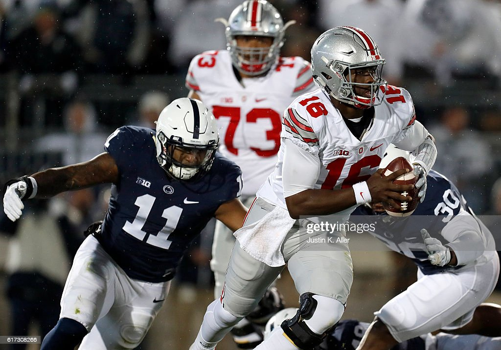 J.T. Barrett #16 of the Ohio State Buckeyes is hurried by Brandon Bell #11 of the Penn State Nittany Lions in the first half during the game on October 22, 2016 at Beaver Stadium in State College, Pennsylvania.