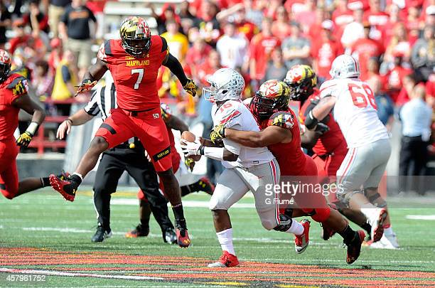 T Barrett of the Ohio State Buckeyes is tackled by Andre Monroe of the Maryland Terrapins at Byrd Stadium on October 4 2014 in College Park Maryland