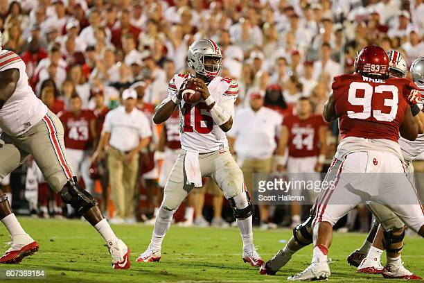 T Barrett of the Ohio State Buckeyes looks to pass against the Oklahoma Sooners at Gaylord Family Oklahoma Memorial Stadium on September 17 2016 in...
