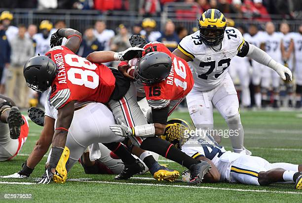 T Barrett of the Ohio State Buckeyes rushes for a first down during overtime of the game against the Michigan Wolverines at Ohio Stadium on November...