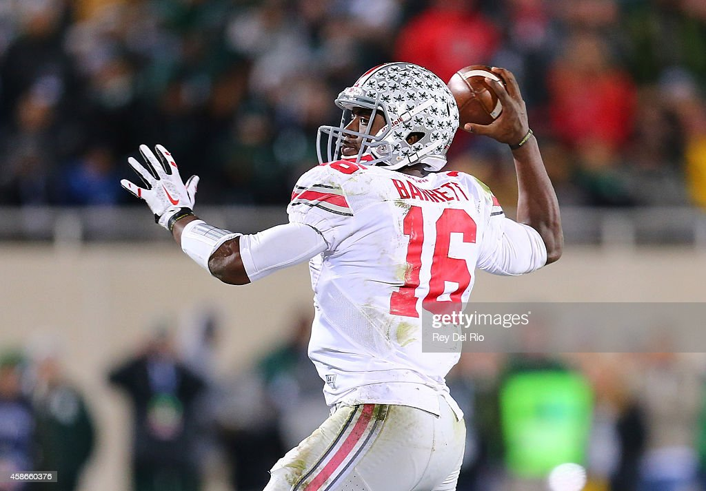 T Barrett of the Ohio State Buckeyes throws against the Michigan State Spartans at Spartan Stadium on November 8 2014 in East Lansing Michigan