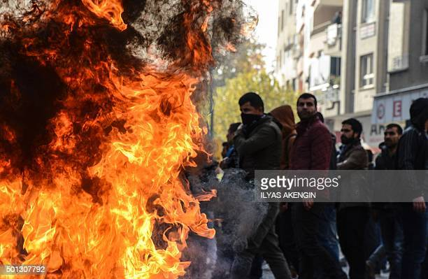A barricade burns as Kurds clash with the Turkish police during a protest against the recent curfews imposed on Kurdish towns on December 14 in...