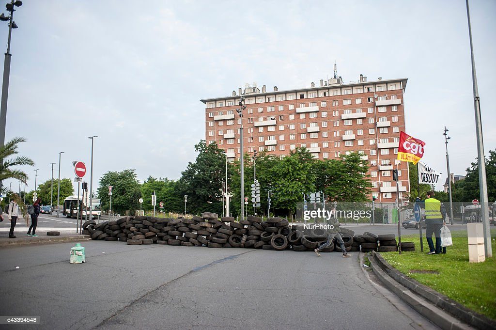 A barricade of tires is installed around the roundabout Posts blocked by trade unionists of the CGT in Lille, France on june 28, 2016. A new national day of action against labor law unfolds in the whole of France. Economic blocking action was planned by the CGT in Lille this morning at 6:30 am.