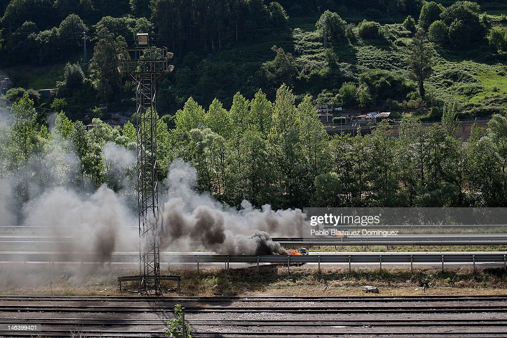 A barricade of tyres burns on the motorway A-66 near Mieres on June 15, 2012 in northern Spain. Spanish coal miners are staging a nationwide strike organised by unions opposed to subsidy reductions from 300 million to 110 million Euros.