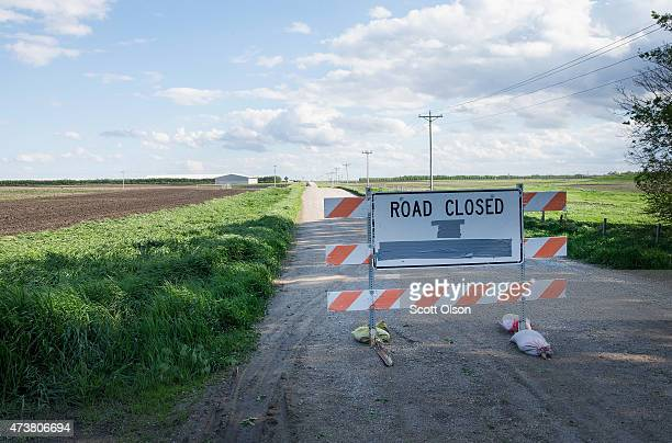 A barricade sits in the road leading to a farm operated by Daybreak Foods which has been designated 'bio security area' on May 17 2015 near Eagle...