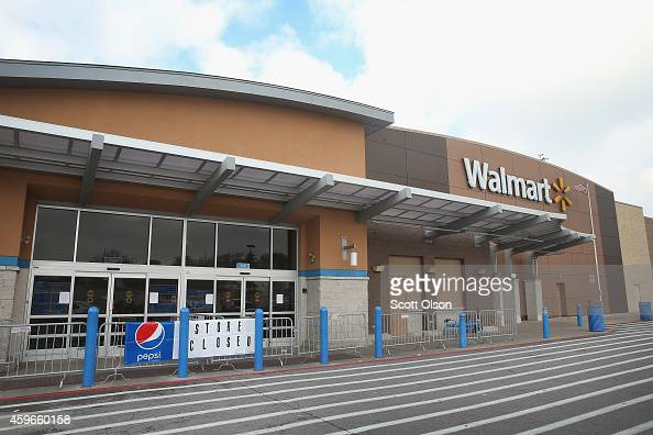 Barricades and a store closed sign sit in front of a WalMart store on Thanksgiving Day November 27 2014 near Ferguson Missouri The Ferguson area has...