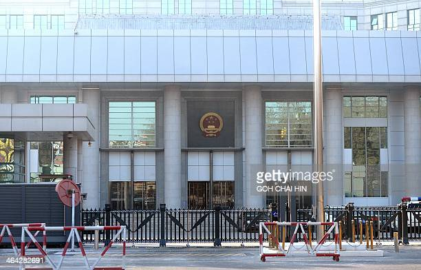 Barricades are set up outside the No 1 Intermediate court in Beijing on January 22 as strict security was imposed outside a courthouse ahead of the...