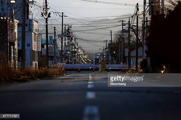 Barricades block a road in an area damaged by the tsunami following the March 2011 earthquake in Namie Fukushima Prefecture Japan on Monday March 10...