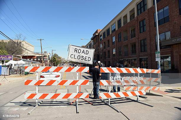 Barricades stand near the scene of a deadly car accident at the South by Southwest Music Film and Interactive Festival on March 13 2014 in Austin...