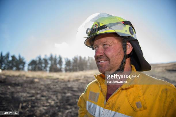 Barrie Begg of the Lauriston Rural Fire Force looks on on February 20 2017 in Christchurch New Zealand Firefighters continue to work to contain fires...