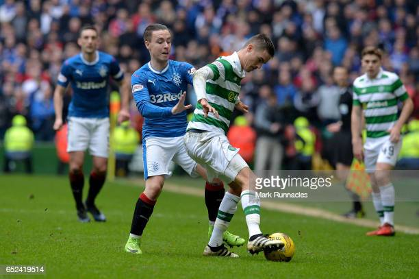 Barrie McKay of Rangers and Mikael Lustig of Celtic battle for possession during the Ladbrokes Scottish Premiership match between Celtic and Rangers...