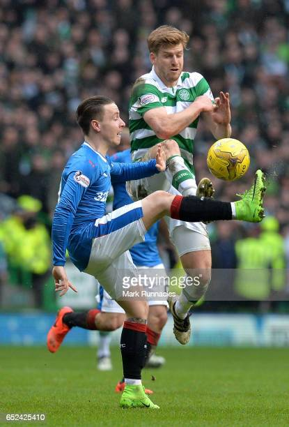 Barrie McKay of Rangers and Stuart Armstrong of Celtic battle for possession during the Ladbrokes Scottish Premiership match between Celtic and...