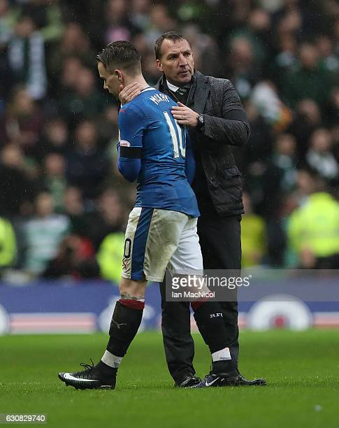 Barrie McKay of Rangers is consoled by Celtic manager Brendan Rogers at full time during the Rangers v Celtic Ladbrokes Scottish Premiership match at...