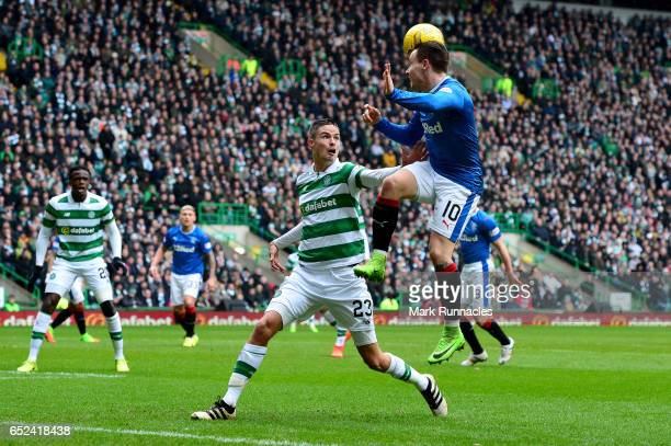 Barrie McKay of Rangers wins a header over Mikael Lustig of Celtic during the Ladbrokes Scottish Premiership match between Celtic and Rangers at...
