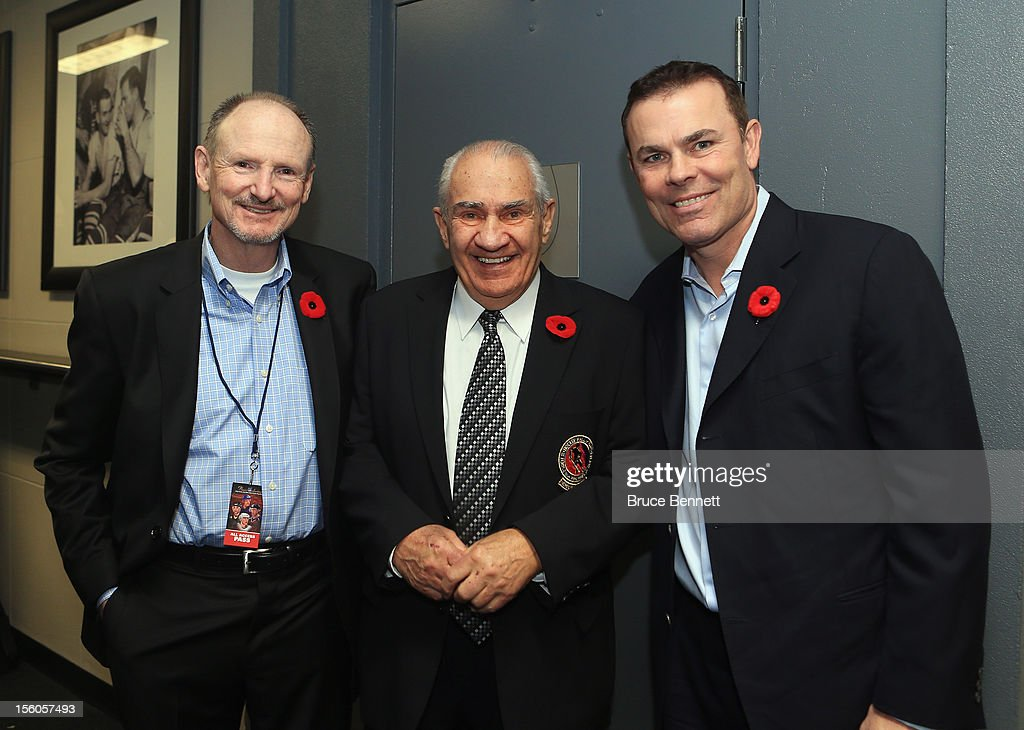 Barrie Stafford, Jim Gregory of the Hall of Fame and Adam Oates, pose for a photo prior to the Hockey Hall of Fame Legends Game at the Air Canada Centre on November 11, 2012 in Toronto, Canada. Stafford, the long time trainer for the Edmonton Oilers will be honored along with Oates at the Hockey Hall of Fame induction ceremony at the Hall on November 12.