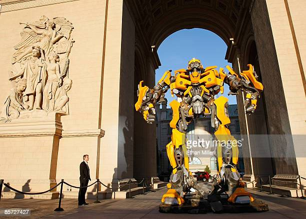 Barrie Woolston of England looks at a large model of the Bumblebee character from the movie 'Transformers' at the Paris Las Vegas during ShoWest the...