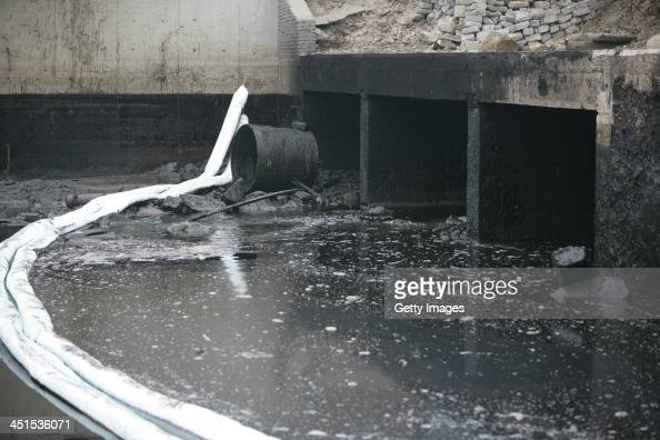 A barrier is seen to protect the sea from an oil spill after a oil pipeline exploded on November 23 2013 in Qingdao China The death toll from the...