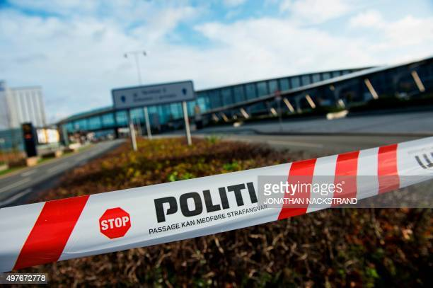 A barrier tape of the police is seen outside terminal 3 at Kastrup airport in Copenhagen on November 18 2015 Danish police evacuated one of two...