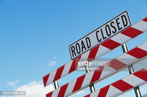 Barrier with road closed sign, low angle view : Stock Photo