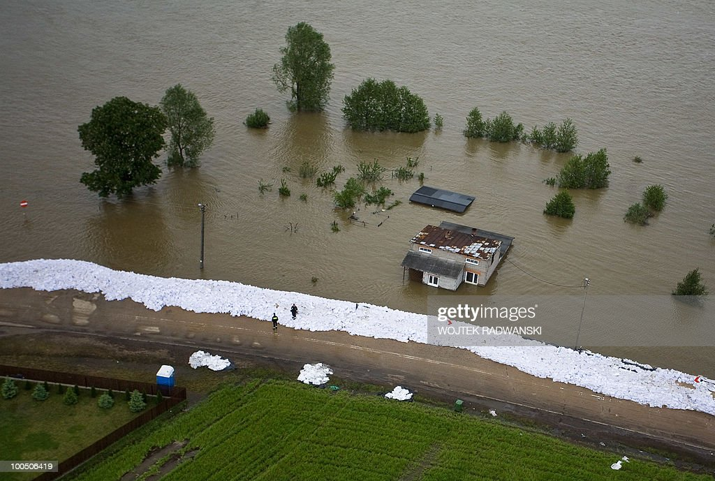 Barriers made of sand bags against rising floodwaters are seen in Dobrzykow in central Poland on Wisla river on May 25, 2010. Torrential rain in Poland's mountainous south have caused rivers, including the Vistula, Poland's largest, swell to levels unseen in more than a century.