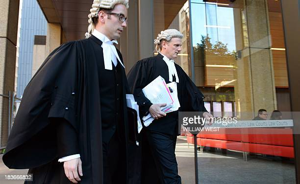Barrister Christopher Withers and an unidentified legal associate acting for John Hancock enter the Supreme Court of New South Wales in Sydney on...