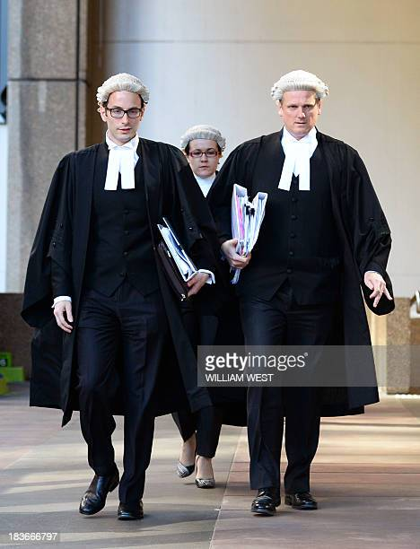 Barrister Christopher Withers and an unidentified legal associates acting for John Hancock enter the Supreme Court of New South Wales in Sydney on...