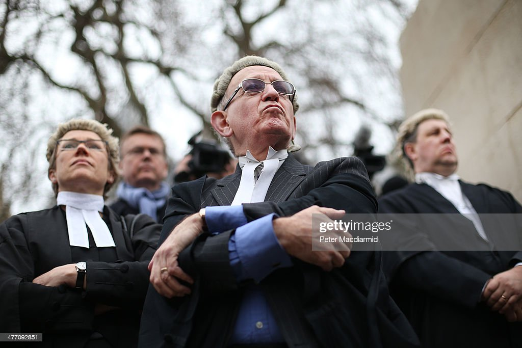 Barristers and solicitors hold a demonstration outside Parliament on March 7, 2014 in London, England. The legal profession is rallying against the Government's proposed cuts to legal aid fees.