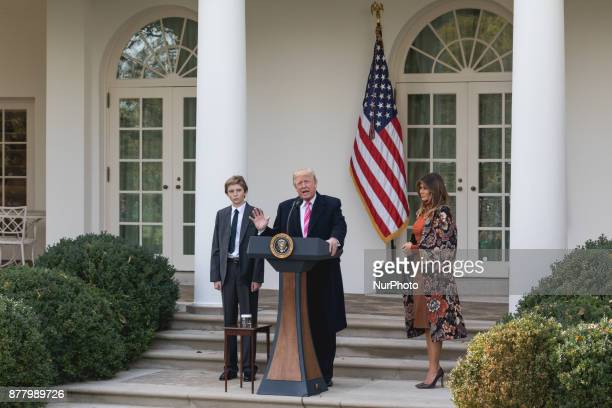 Barron Trump and his Mom First Lady Melania Trump stand next to President Donald Trump as he speaks at the National Thanksgiving Turkey Pardoning...