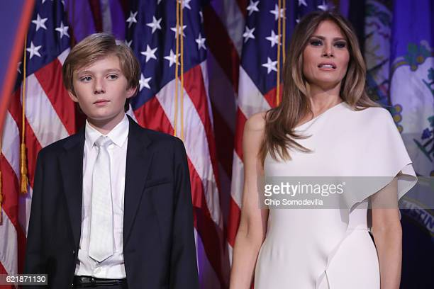 Barron Trump and his mother Melania Trump stand on stage after Republican presidentelect Donald Trump delivered his acceptance speech at the New York...