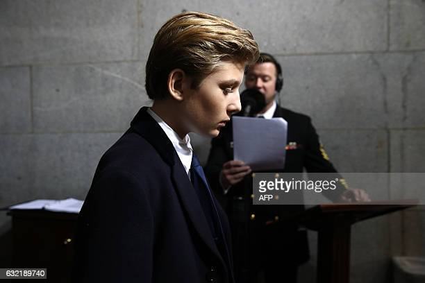 TOPSHOT Barron Trump arrives on the West Front of the US Capitol on January 20 2017 in Washington DC Donald Trump took the first ceremonial steps...